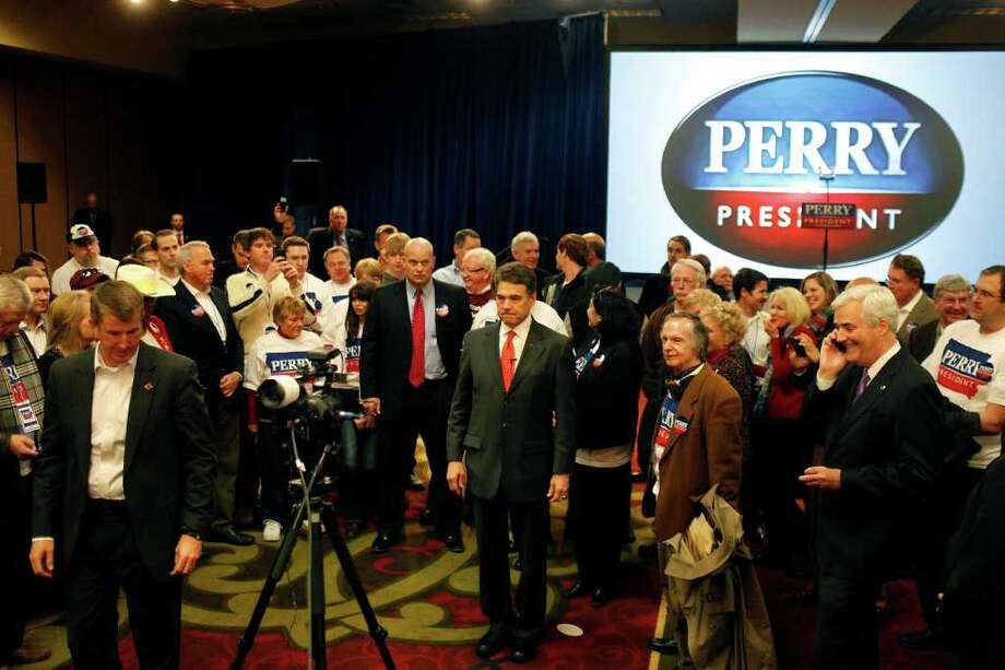 Republican presidential candidate Gov. Rick Perry waits to do an interview with Fox News during his Caucus Watch Party at the Sheraton in West Des Moines on Tuesday, Jan. 3, 2012. Photo: LISA KRANTZ, SAN ANTONIO EXPRESS-NEWS / SAN ANTONIO EXPRESS-NEWS