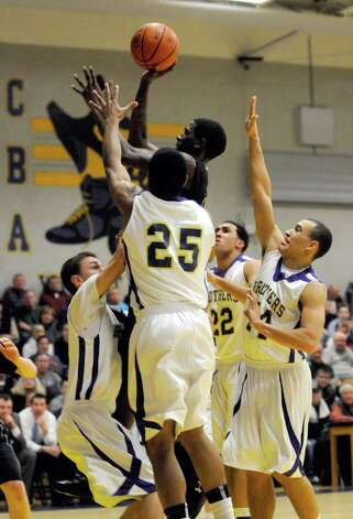 Troy's Trahmier Burrell trys to get through CBA defenders during their boy's high school basketball matchup in Colonie,NY Tuesday, Jan.3, 2012. ( Michael P. Farrell/Times Union) Photo: Michael P. Farrell
