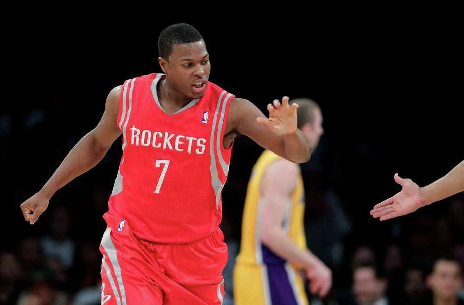 Houston Rockets' Kyle Lowry slaps hands with a teammate after making a basket during the first half of an NBA basketball game against the Los Angeles Lakers in Los Angeles, Tuesday, Jan. 3, 2012. (AP Photo/Jae C. Hong) Photo: Jae C. Hong, Associated Press / AP