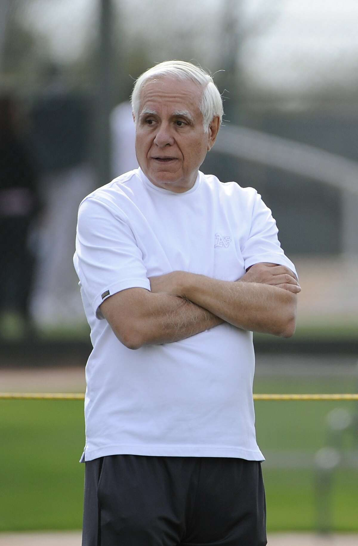 FILE - This Feb. 16, 2009, file photo shows Oakland Athletics owner Lew Wolff during spring training baseball in Phoenix. Wolff tells the AP he hopes Frank McCourt will soon sell the Los Angeles Dodgers so baseball can move forward.