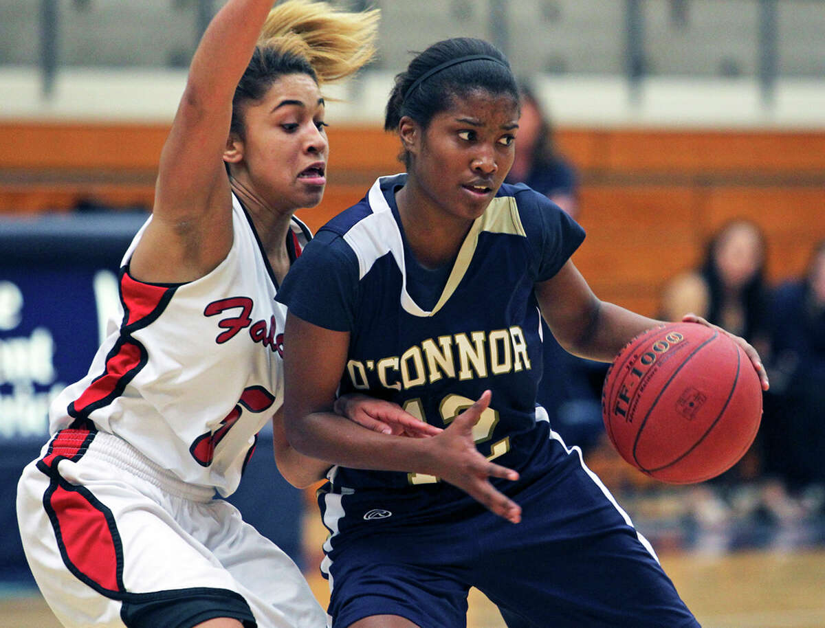 O'Connor's Alexis Copeland pivots in the lane against Stevens' Samira Rodriguez at Taylor Field House on Tuesday, Jan. 3, 2012.