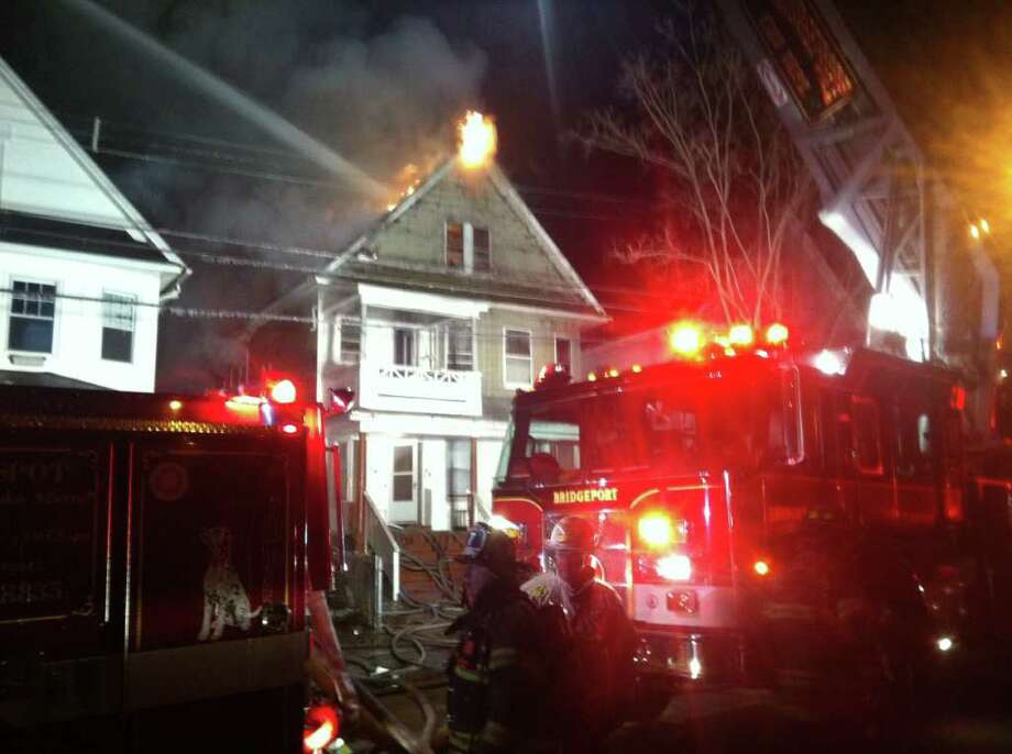 Bridgeport firefighters work to extinguish a blaze at 17 Worth Street in Bridgeport on Wednesday, Jan 4, 2012. Photo: Tom Cleary