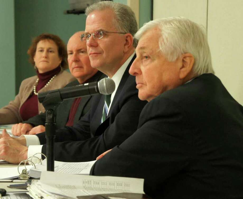 Westport Superintendent of Schools Elliott Landon, right foreground, unveiled a $100.5 million budget for the 2012-13 fiscal year at Tuesday's Board of Education meeting. From left, are board members Elaine Whitney, James Marpe and Chairman Don O'Day. Photo: Paul Schott / Westport News