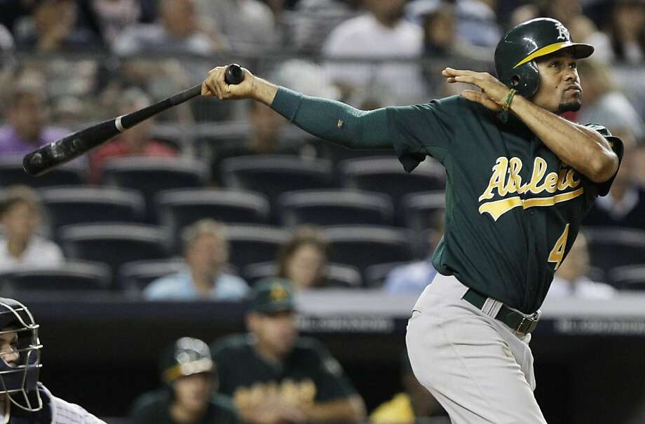 Oakland Athletics' Coco Crisp follows through on a three-run home run during the 10th inning of a baseball game against the New York Yankees on Wednesday, Aug. 24, 2011, at Yankee Stadium in New York. The Athletics won 6-4. (AP Photo/Frank Franklin II) Photo: Frank Franklin II, Associated Press