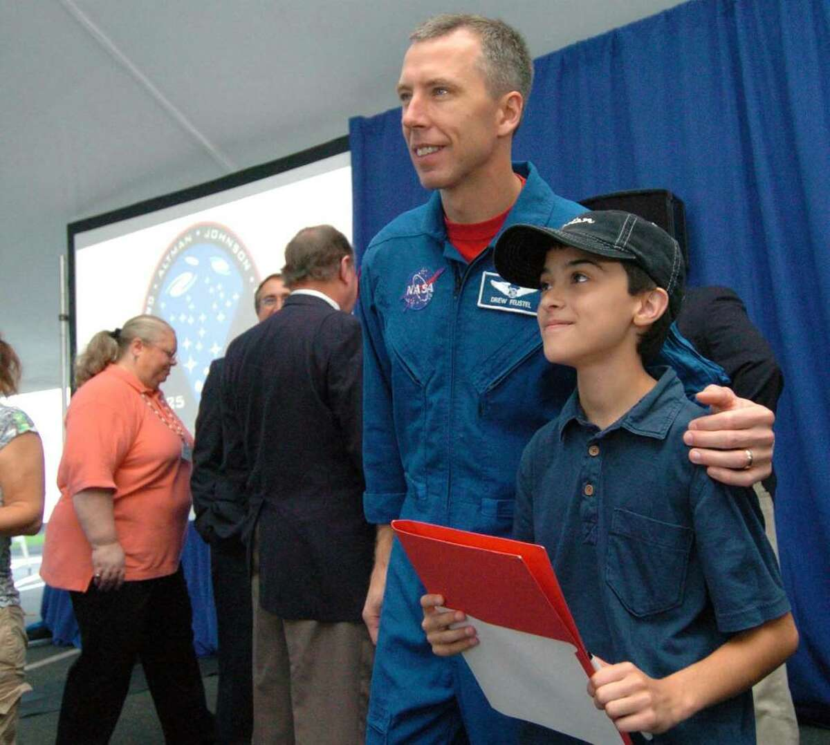Astronaut Drew Feustel has his photo taken with Brandon Charron, 10 from Torrington at a presentation about the Hubble Telescope at Goodrich Optical Corporation in Danbury, CT August 18, 2009.