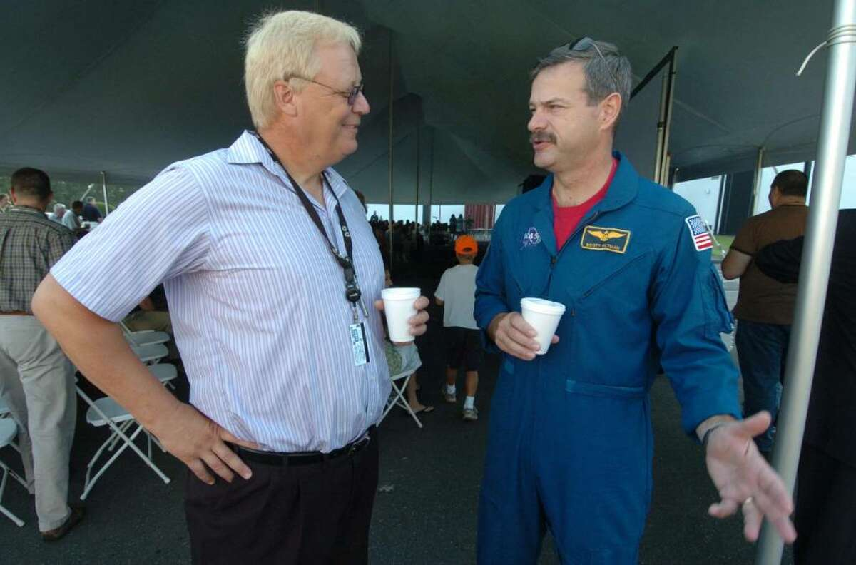 Rich Filicko, from Goodrich Optical Corporation chats with Astronaut Scott Altman at a presentation about the Hubble Telescope at Goodrich Optical Corporation in Danbury, CT August 18, 2009.