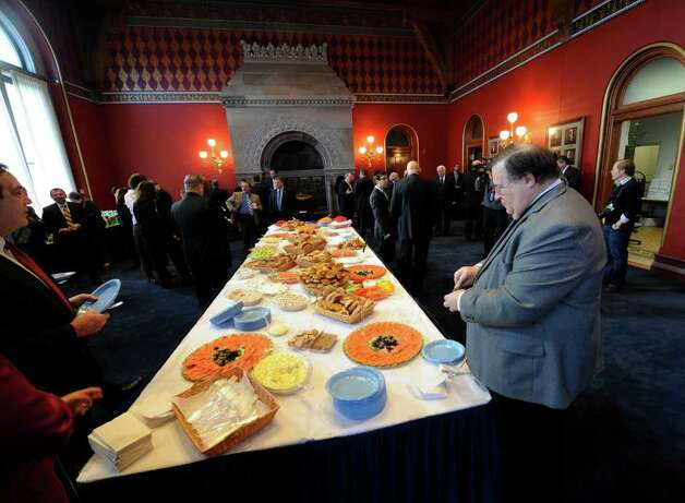 PEF President Ken Brynien visits the food table at the Speakers Breakfast in the State Capitol on State of the State day in Albany, N.Y. Jan. 4, 2011.   (Skip Dickstein / Times Union) Photo: SKIP DICKSTEIN / 10015982A