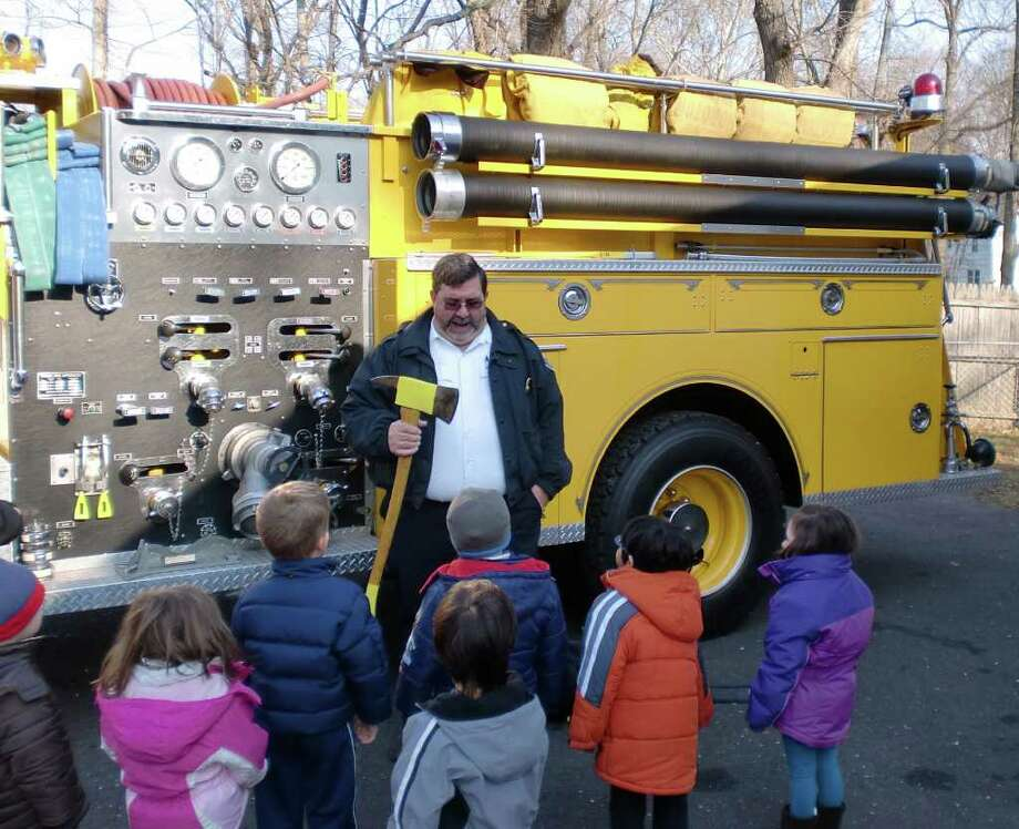 Fire Marshal Robert Buch teaches the students about fire safety. Photo: Contributed Photo