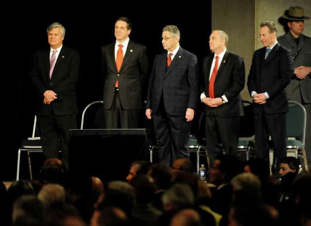 Governor Andrew Cuomo stands with other heads of the State including; Senate Majority Leader Dean Skelos, right;  Governor Andrew Cuomo; Assembly Speaker Sheldon Silver; Comptroller Thomas DiNapoli and Attorney General Eric T. Schneiderman before the Governor's State of the State Adresses in the Convention Center in the Empire State Plaza  in Albany, N.Y. to give The Governor's Annual State of the State message Jan. 4, 2011.   (Skip Dickstein / Times Union) Photo: SKIP DICKSTEIN / 10015982A