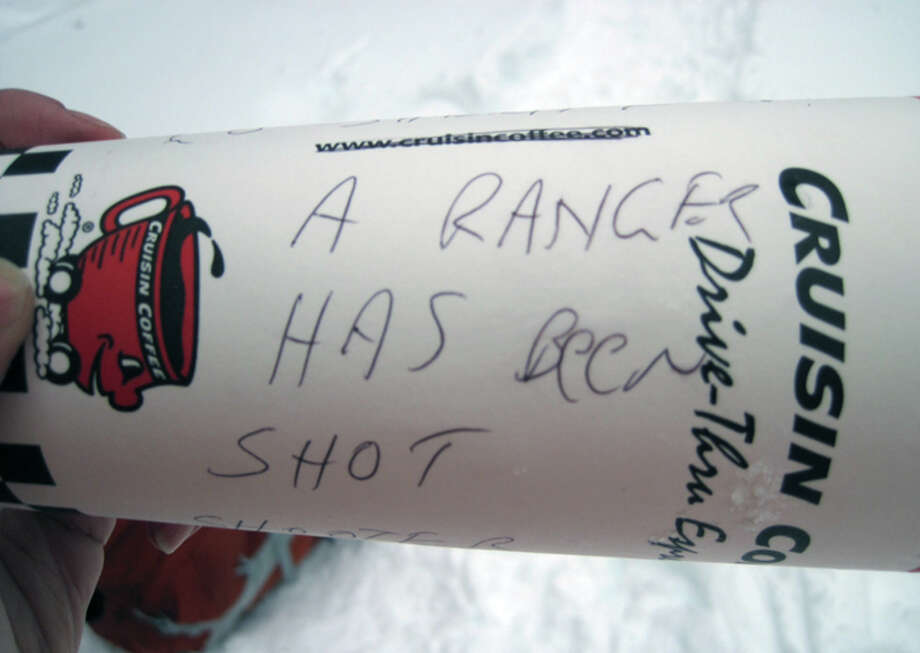 "A cup dropped to hikers at Reflection Lakes from a Pierce County Sheriff's Office aircrew. It reads ""A ranger has been shot."" Photo by Jen Berthiaume. Photo: Courtesy Photo"
