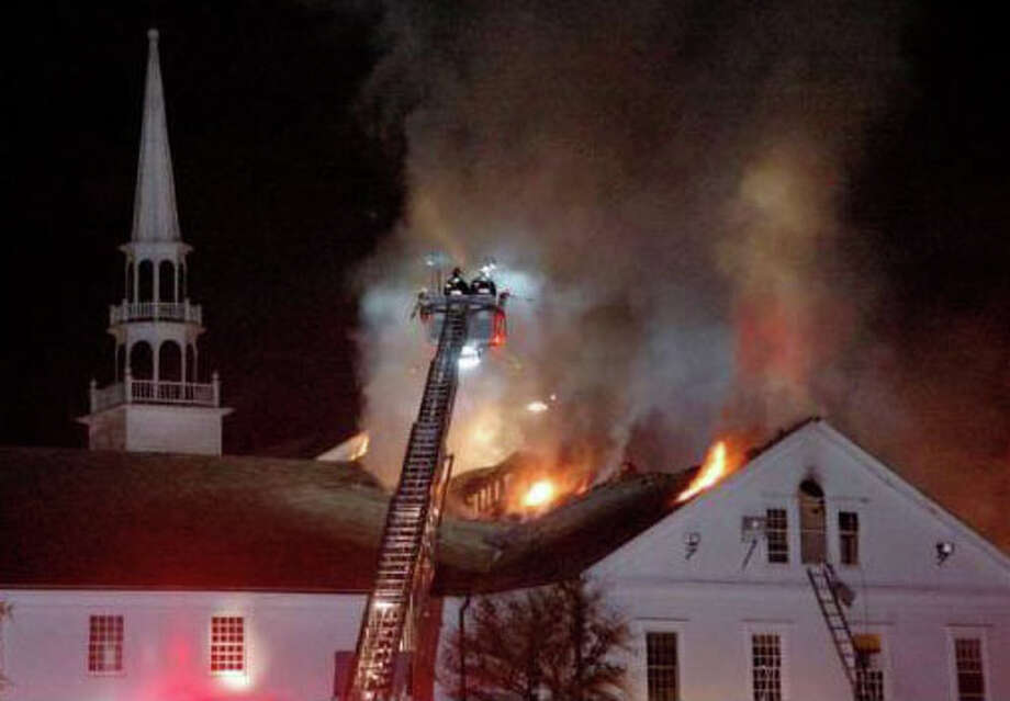 Firefighters battle a fire at Saugatuck Congregational Church on Nov. 20, 2011. Photo: Cathy Zuraw/Connecticut Post, Cathy Zuraw / Westport News contributed