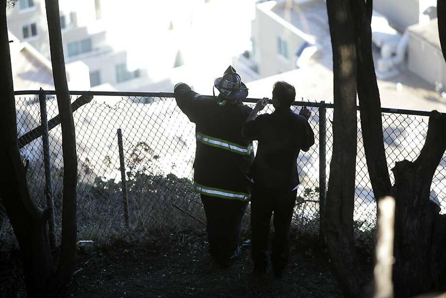 Members of the San Francisco Fire Department work on Telegraph Hill to narrow down the location of a burglary suspect on Wednesday, January 4, 2012 in San Francisco, Calif. Photo: Lea Suzuki, The Chronicle