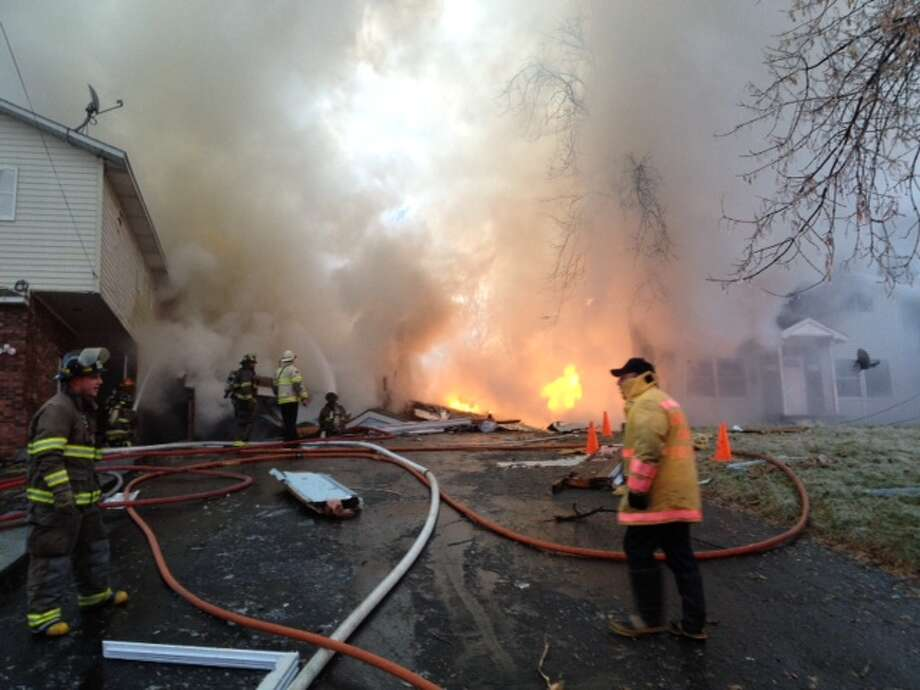 Firefighters battle a fire on the 2100 block of Avenue B in Schenectady, N.Y., after a home exploded on Wednesday, Jan. 5, 2012.  (Lori Van Buren / Times Union)