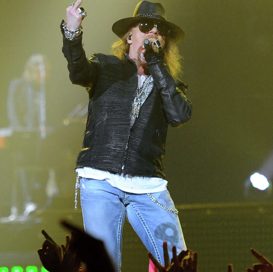Axl Rose of Guns N' Roses performs at the Hard Rock Hotel & Casino on Dec. 30, 2011 in Las Vegas... wait a minute, are those mom jeans? Yes, they're ripped and adorned with chains, but that light wash is unmistakable. / 2011 Getty Images