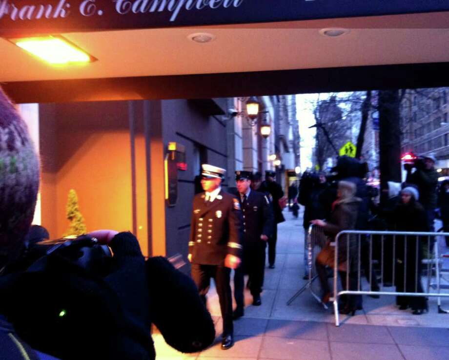Stamford firefighters enter Frank E. Campbell Funeral Chapel on Madison Avenue in New York City Wednesday afternoon to pay respects to the three girls who died in a Christmas day house fire in Stamford. Photo: Maggie Gordon
