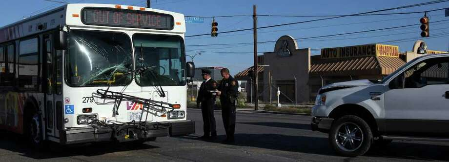 Police take notes at the scene of an accident on the Northwest Side Wednesday at Fredericksburg road and De Chantle where a Ford pickup truck collided with a VIA bus. Photo: JOHN DAVENPORT, SAN ANTONIO EXPRESS-NEWS