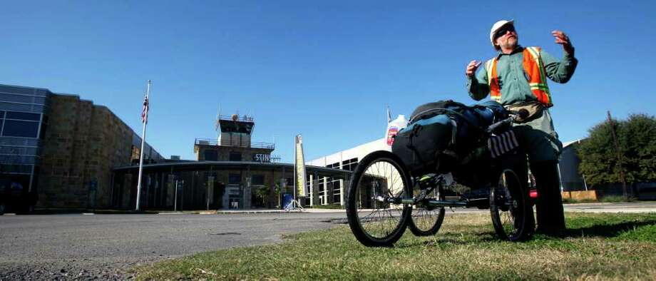 Bart Smith pauses in front of Stinson Airport from his walk along the Mission Trail, part of the larger El Camino Real de los Tejas that runs from Natchitoches, La. to Eagle Pass. Photo: WILLIAM LUTHER, SAN ANTONIO EXPRESS-NEWS / 2012 SAN ANTONIO EXPRESS-NEWS
