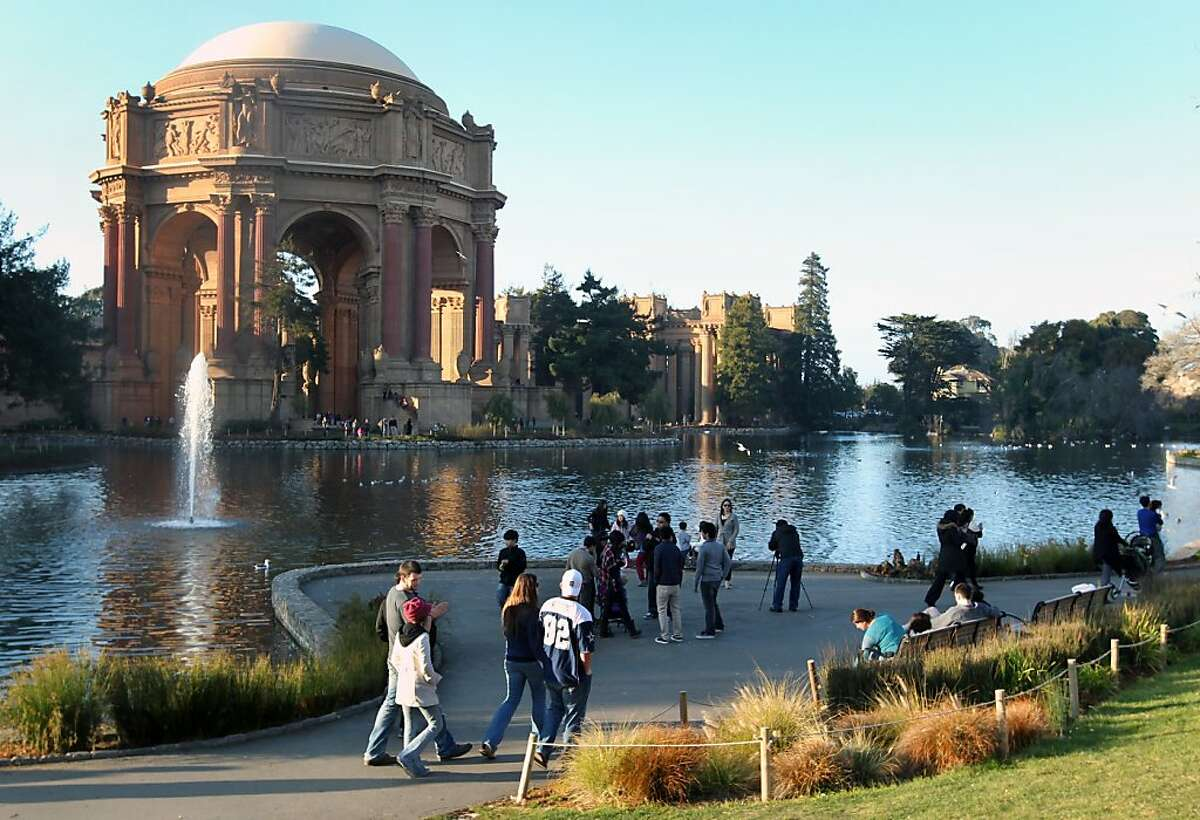 Visitors to the exquisite Palace of Fine Arts that showcased artworks during the 1915 Panama-Pacific exposition, which celebrated the opening of the Panama Canal tour the grounds Sunday, January 1, 2012.
