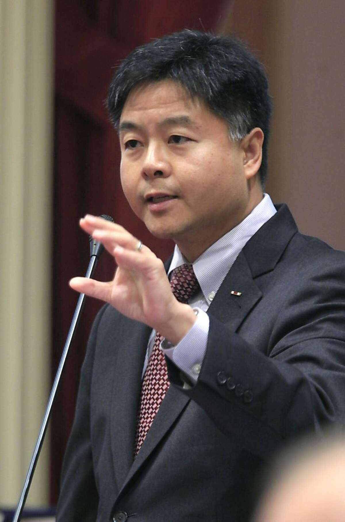 FILE- This file photo taken Sept. 9, 2011, shows California State Sen. Ted Lieu , D-Torrance , as he speaks before the Senate at the Capitol in Sacramento, Calif. Lieu is considering calling for a boycott of Lowe's stores after the home improvement chain pulled its advertising from a reality show about Muslim-Americans. Calling the retail giant's decision