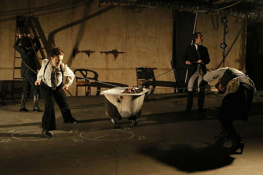 """The cast of Mugwumpin's """"Future Motive Power"""" during a rehearsal in the Old Mint Building in San Francisco, Calif., on Wednesday, December 21, 2011.  From left, Rami Margron, Natalie Greene, Joseph Estlack (in tub), Christopher W. White, and Misti Boetigger perform.  The play is inspired by the peculiar life of Nikola Tesla. Photo: Dylan Entelis, The Chronicle"""