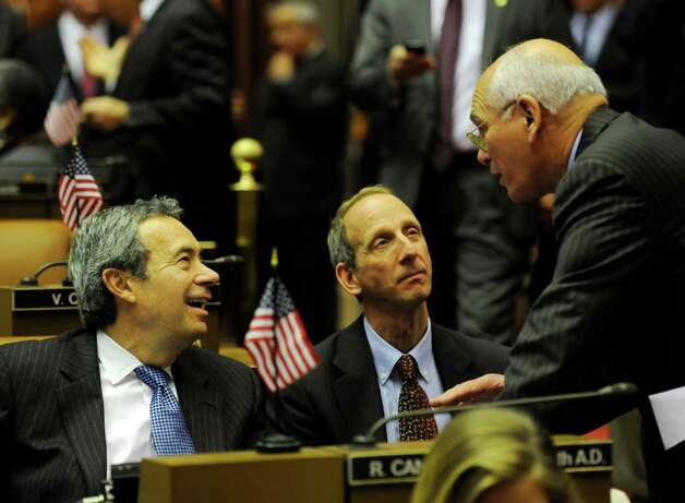 Assembly Majority Leader Ron Canestrari, left shares a laugh with Congressman Paul Tonko, right in the Assembly Chamber before going to the Convention Center in the Empire State Plaza  in Albany, N.Y. to hear The Governor's Annual State of the State message Jan. 4, 2011.   (Skip Dickstein / Times Union) Photo: SKIP DICKSTEIN / 10015982A