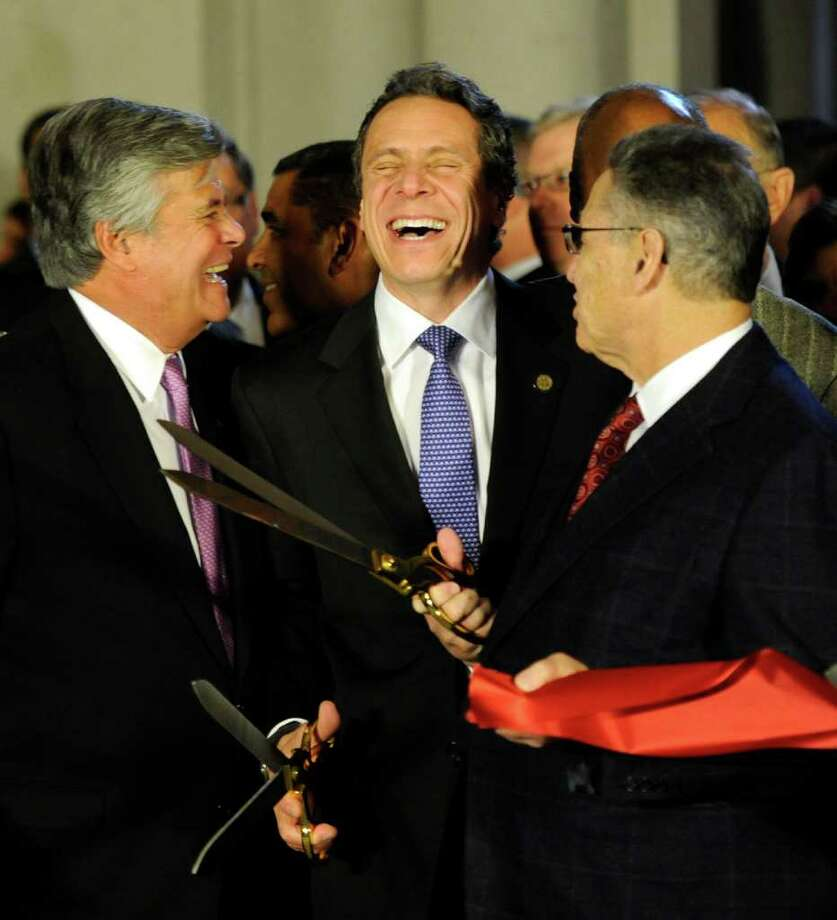 Senate Majority Dean Skelos, left, Governor Andrew Cuomo, center and Assembly Speaker Sheldon Silver, right try to figure out who cut the ceremonial ribbon on the renovated portions of the Capitol first  before going to the Convention Center in the Empire State Plaza  in Albany, N.Y. to hear The Governor's Annual State of the State message Jan. 4, 2011.   (Skip Dickstein / Times Union) Photo: SKIP DICKSTEIN / 10015982A