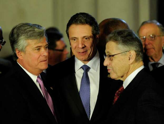 Senate Majority Dean Skelos, left, Governor Andrew Cuomo, center and Assembly Speaker Sheldon Silver, right get their heads together before going to the Convention Center in the Empire State Plaza  in Albany, N.Y. to hear The Governor's Annual State of the State message Jan. 4, 2011.   (Skip Dickstein / Times Union) Photo: SKIP DICKSTEIN / 10015982A