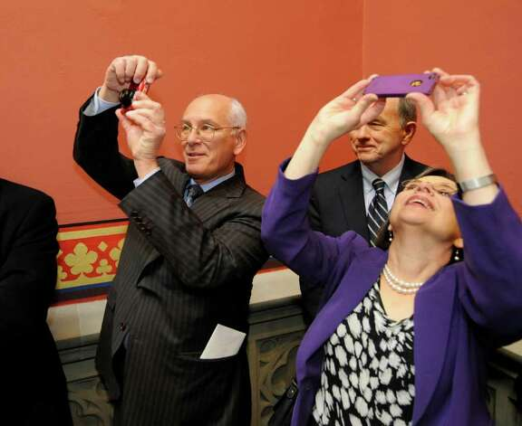Congressman Paul Tonko, left makes pictures of the refurbished skylight in the above the Assembly staircase in the State Capitol in Albany, N.Y. as assemblyman Bob Reilly, center watches Jan, 4, 2012 (Skip Dickstein / Times Union) Photo: SKIP DICKSTEIN / 10015982A
