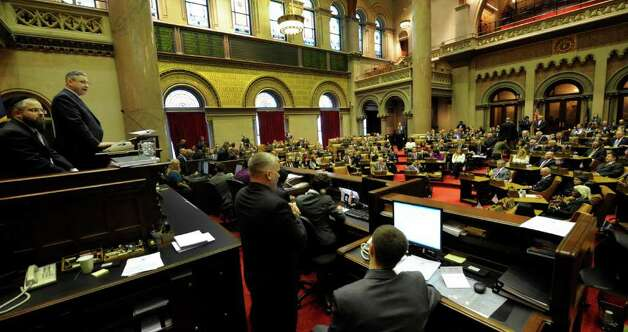 Assembly Speaker Sheldon Silver, left convenes the 2012 session of the Assembly  before going to the Convention Center in the Empire State Plaza  in Albany, N.Y. to hear The Governor's Annual State of the State message Jan. 4, 2011.   (Skip Dickstein / Times Union) Photo: SKIP DICKSTEIN / 10015982A