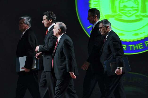New York State Governor Andrew Cuomo, second from left, walks off the stage after delivering his second State of the State address, accompanied by Senate Majority Leader Dean Skelos, left, State Comptroller Thomas DiNapoli, center, Lieutenant Governor Robert Duffy, second from right,  and Assembly Speaker Sheldon Silver, right, at the Empire State Plaza Convention  Center on Wednesday Jan. 4, 2012 in Albany, NY. (Philip Kamrass / Times Union ) Photo: Philip Kamrass / 10015982B