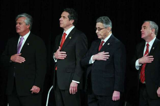 New York State Governor Andrew Cuomo, second from left,  before delivering his second State of the State address, with Senate Majority Leader Dean Skelos, left, Assembly Speaker Sheldon Silver, second from right, and State Comptroller Thomas DiNapoli, right, at the Empire State Plaza Convention  Center on Wednesday Jan. 4, 2012 in Albany, NY. (Philip Kamrass / Times Union ) Photo: Philip Kamrass / 10015982B