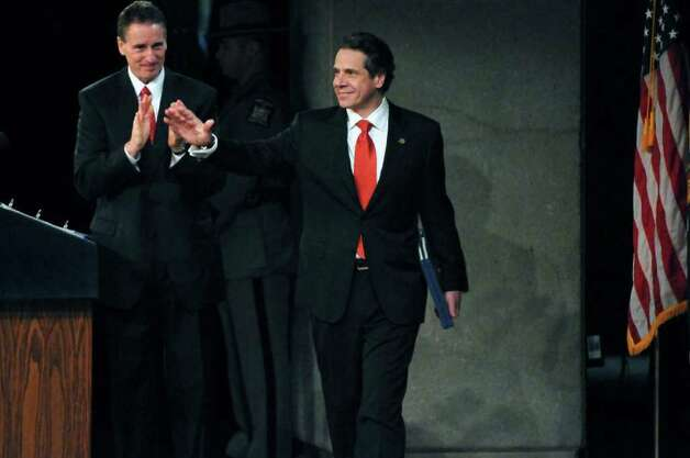 New York State Governor Andrew Cuomo waves to the audience as he walks onstage to deliver his second State of the State address at the Empire State Plaza Convention  Center on Wednesday Jan. 4, 2012 in Albany, NY. Lieutenant Governor Robert Duffy introduced him, at left. (Philip Kamrass / Times Union ) Photo: Philip Kamrass / 10015982B