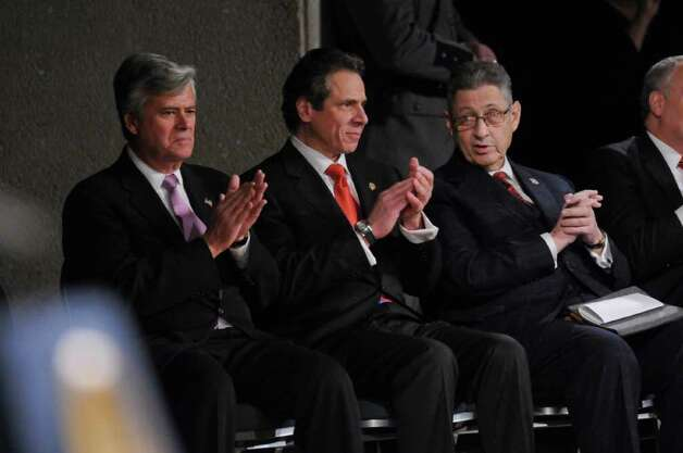 New York State Governor Andrew Cuomo, center, sits with Senate Majority Leader Dean Skelos, left, and Assembly Speaker Sheldon Silver, right, before deliveing his second State of the State address at the Empire State Plaza Convention  Center on Wednesday Jan. 4, 2012 in Albany, NY. (Philip Kamrass / Times Union ) Photo: Philip Kamrass / 10015982B