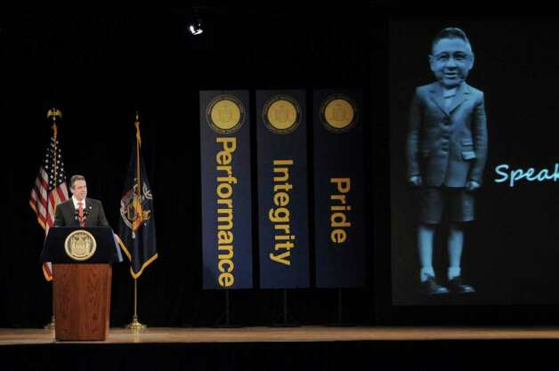 New York State Governor Andrew Cuomo draws laughs as he shows a humorous picture of the face of Assembly Speaker Sheldon Silver superimposed on the body of a child, as he delivers  his second State of the State address at the Empire State Plaza Convention  Center on Wednesday Jan. 4, 2012 in Albany, NY. (Philip Kamrass / Times Union ) Photo: Philip Kamrass / 10015982B