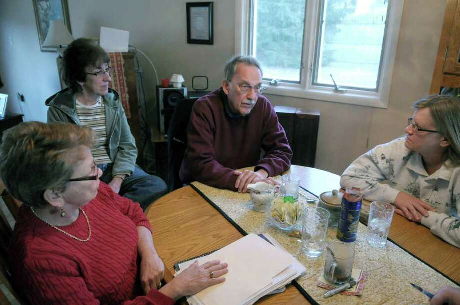 From left to right, Barbara Wood, Agnes Donlon, Bob Wiltsie and Dayle Scott talk about their concerns over a massive Dollar Tree distribution center on Wednesday, Jan. 4, 2012 in Schodack, NY.  Some neighbors in the area have concerns and unanswered questions about center which would butt up against the residential neighborhood.   (Paul Buckowski / Times Union) Photo: Paul Buckowski