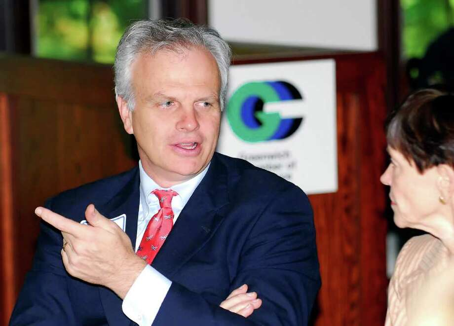 JetBlue founder and New Canaan resident David Neeleman, left, speaks at a Greenwich Chamber of Commerce meeting at the Milbrook Club, in this October 2007 file photo. Photo: Luckey,Bob, Greenwich Time File / SCNI