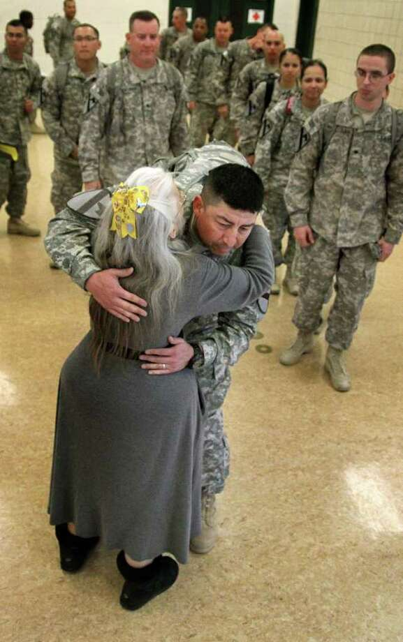 The 'Hug Lady,' Elizabeth Laird of Copperas Cove, hugs a soldier as others wait in line during the homecoming of the 3rd Brigade, 1st Cavalry Division at Fort Hood. Photo: MARIANNE LIJEWSKI, ASSOCIATED PRESS