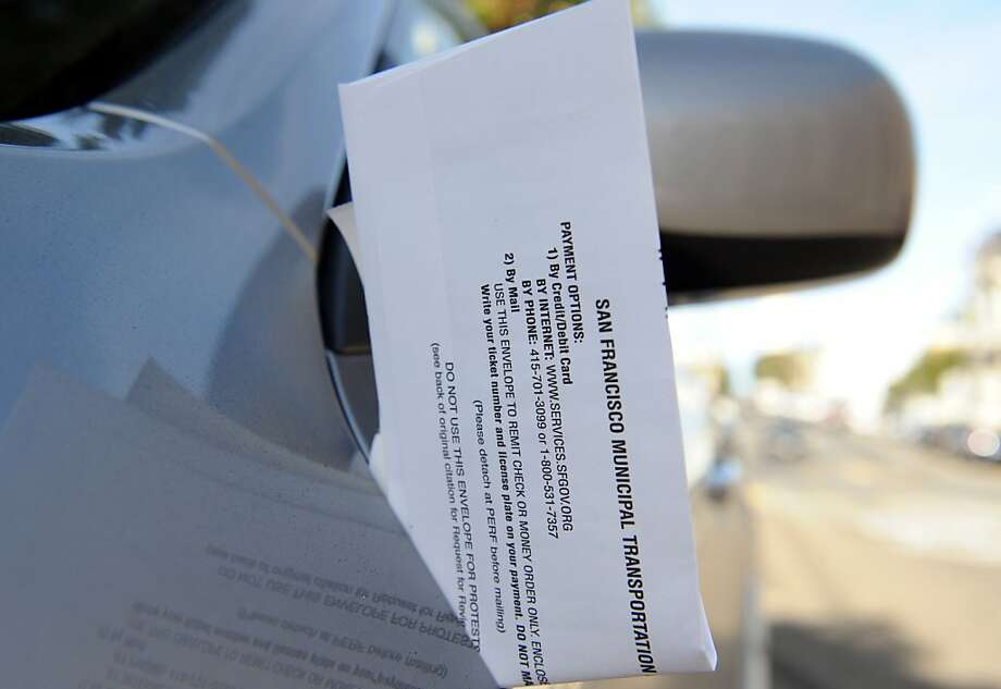 A parking ticket is seen on a car on  January 4, 2012. SF is collecting less money from parking fines and more money from plugging the meters under San Francisco's innovative parking management program. Photo: Susana Bates, Special To The Chronicle