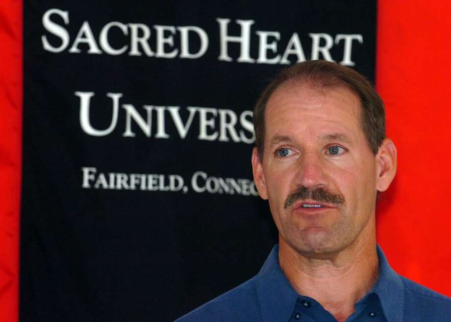 """Bill Cowher, former head coach of the Pittsburg Steelers, speaks during a press conference prior to presenting his lecture """"Blueprint for Winning"""" at Sacred Heart University, in Fairfield, Conn. Monday evening, Oct. 26th, 2009. Photo: Ned Gerard / Connecticut Post"""