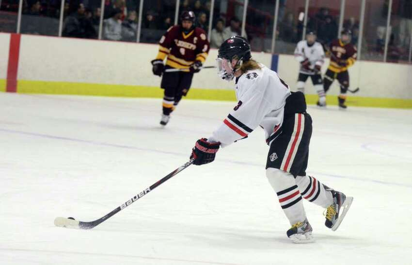 New Canaan's Spencer Manchuck (3) during the boys ice hockey game against St. Joseph at the Darien Ice Rink on Wednesday, Jan. 4, 2012.