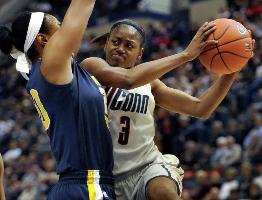 Connecticut's Tiffany Hayes, right, drives to the basket while guarded by West Virginia's Asya Bussie, left, first half of an NCAA college basketball game in Hartford, Conn., Wednesday, Jan. 4, 2012. (AP Photo/Jessica Hill) Photo: Jessica Hill/Associated Press / AP2012