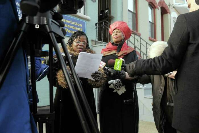 Debora Brown-Johnson, left, president of the Albany branch of the NAACP and Anne Pope, the regional director of the NAACP, talk with members of the media during a press conference they held to discuss the police shooting of Nahcream Moore. (Paul Buckowski / Times Union)
