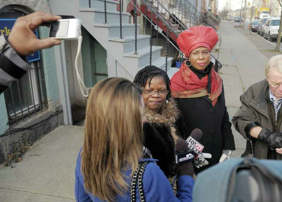 In this file photography, Debora Brown-Johnson, left, president of the Albany branch of the NAACP and Anne Pope, the regional director of the NAACP, talk with members of the media during a press conference they held to discuss the 2011 police shooting of Nahcream Moore. Brown-Johnson says she wants Mayor Kathy Sheehan to address why the overwhelming number of people arrested on marijuana charges in Albany are Black.  (Paul Buckowski / Times Union)