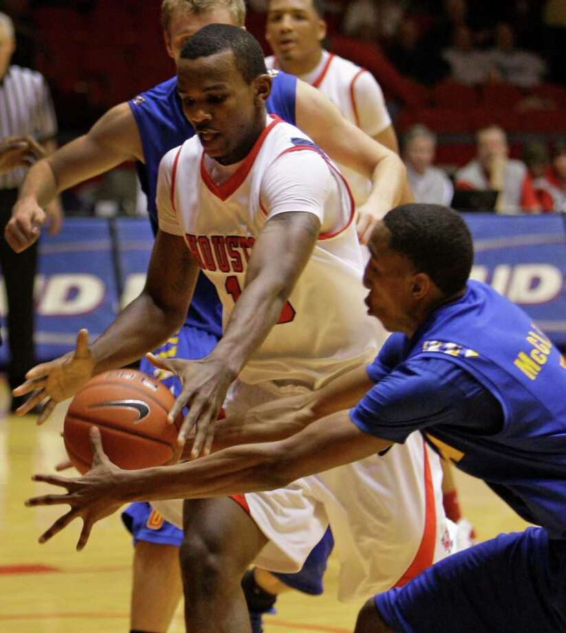 University of Houston Cougars' Leon Gibson, left, and Tulsa Golden Hurricane's Eric McClellan, right,  scramble for the ball during first half of college basketball game at Hofheinz Pavilion at UH Wednesday, Jan. 4, 2012, in Houston. Photo: Melissa Phillip, Houston Chronicle / © 2011 Houston Chronicle