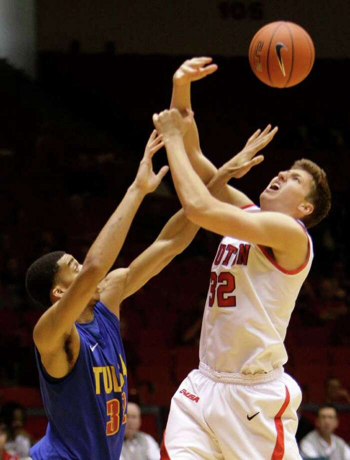 Tulsa's  Kodi Maduka, left,  fouls UH's Kirk Van Slyke. Photo: Melissa Phillip, Houston Chronicle / © 2011 Houston Chronicle