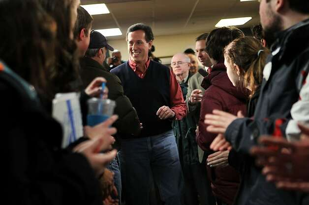 "BRENTWOOD, NH - JANUARY 04:  Republican presidential candidate, former U.S. Sen. Rick Santorum (C) greets voters as he arrives at a town hall meeting on ""Faith, Family and Freedom"" at Rockingham County Nursing Home January 4, 2012 in Brentwood, New Hampshire. Santorum continued his campaign in New Hampshire for the upcoming primary election after he finished second in the Iowa Caucus, losing to Mitt Romney by only eight votes.  (Photo by Alex Wong/Getty Images) Photo: Alex Wong, Getty Images"