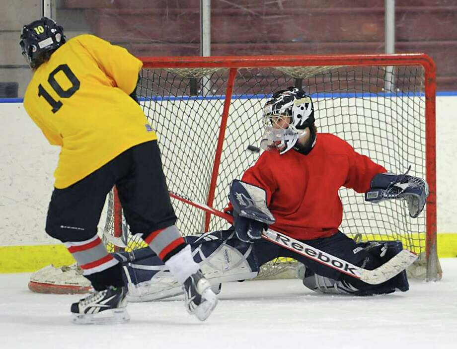 Emily Cassin shoots the puck past goalie Alexandria Shannon during an Albany Academy for Girls ice hockey team practice at the Albany Academy field house Tuesday, Jan. 3, 2012 in Albany, N.Y. (Lori Van Buren / Times Union) Photo: Lori Van Buren