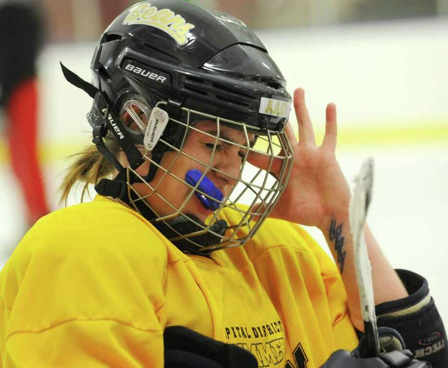 Emily Cassin, 16, scratches her face under her helmet as she listens to her coach talk during the Albany Academy for Girls ice hockey team practice at the Albany Academy field house Tuesday, Jan. 3, 2012 in Albany, N.Y. (Lori Van Buren / Times Union) Photo: Lori Van Buren