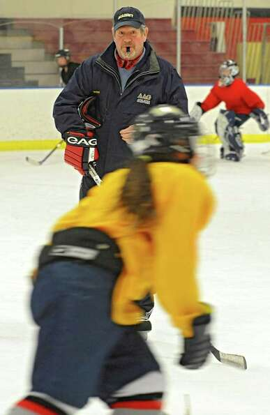 Coach Tom Sheehan during an Albany Academy for Girls ice hockey team practice at the Albany Academy