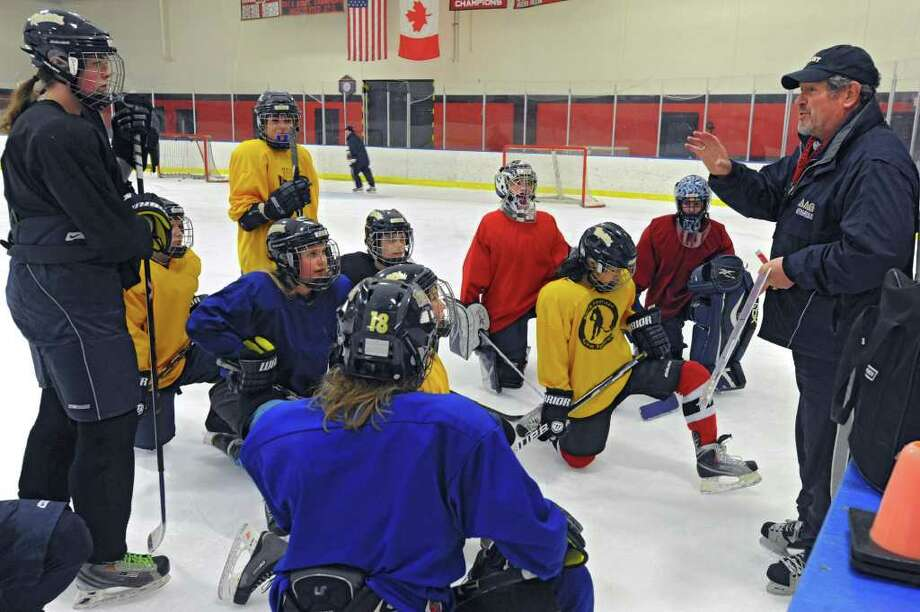 Coach Tom Sheehan talks to his team during an Albany Academy for Girls ice hockey team practice at the Albany Academy field house Tuesday, Jan. 3, 2012 in Albany, N.Y. (Lori Van Buren / Times Union) Photo: Lori Van Buren